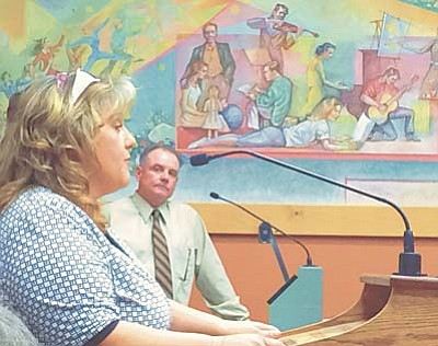 Cindy Barks/PNI<br /><br /><!-- 1upcrlf2 -->Rosie Darby, chairman of the Yavapai Fair Foundation gives a report about the upcoming Yavapai Fair to the Prescott City Council on Tuesday while Prescott Recreation Services Director Joe Baynes, right, looks on.