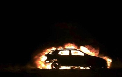 Flames engulf a car involved in a multi-vehicle collision on Highway 169 Saturday night. The photographer said the car was unoccupied when he took this photo. (Courtesy photo by Yuri Howard)