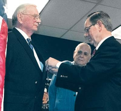 French Honorary Consul for Arizona Gerrit M. Steenblik, right, pins the French Legion of Honor Medal on Dave Hamilton, left. Hamilton's fellow honoree, Sgt. Arthur L. Herzberg, looks on at center. (Courtesy photo)