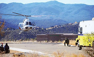 A helicopter lands near the Home Depot store on Highway 69 in Prescott Valley. The store was shut down for about five hours Monday because of a bomb threat. (Les Stukenberg/PNI)