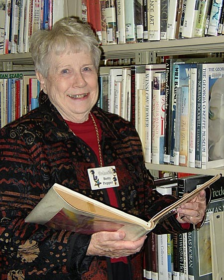 VVN/Michelle Borgwardt:  <b>Betty Pepper</b> began volunteering at Sedona Public Library in October 1988. Service pins adorn her name badge as a testament to her unwavering dedication.