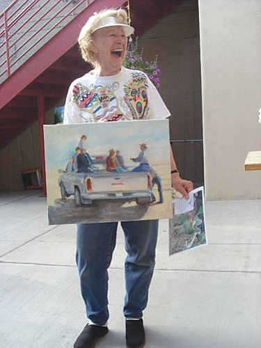 Painter Judith Richter with a painting she produced during the June Second Saturday Art Walk in Old Town at Wind Dancer Gallery.