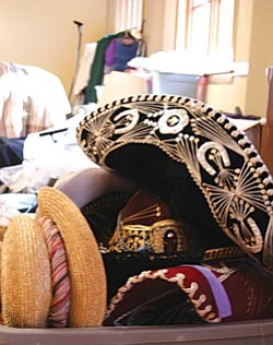 VVN/Raquel Hendrickson<br> Costumes from Verde Valley Theatre are stacked and stored in the Grand Theater on Main Street in Clarkdale. Plans are to eventually turn the historic building into a performance hall, but for now it is used for VVT storage and workspace.