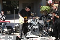 Joe Neri (center) leads Blues Dawg in the season's final concert at Old Town Center for the Arts.