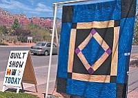 QuiltFest 2011, set for April 30 in Sedona, features a custom designed southwest appliquéd Raffle Quilt (left).