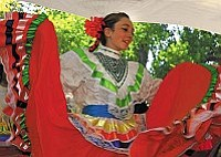 Ballet Amistad Folklorico, the traditional dance troupe comprised of children and adults who twirl and dance with skillful precision. Experience a cultural infusion of folk dancing with authentic, colorful hand-made costumes from every region of Mexico.    Photos by Wib Middleton