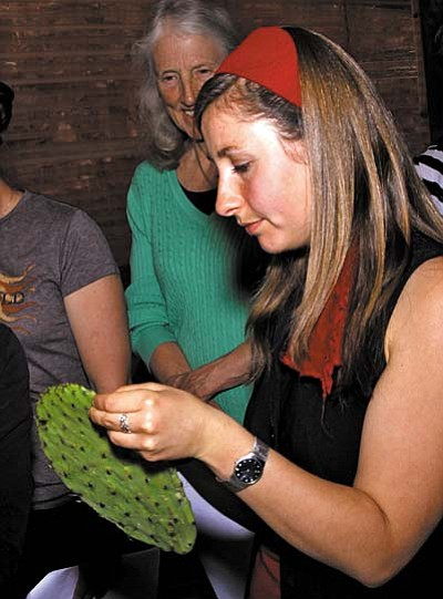 """Mira Murphy demonstrates how to prepare nopal cactus in her Spring Planting Festival workshop """"Cooking with Native and Local Foods."""" During the Spring Planting Festival she teaches how to create a meal based on the local food available including nopal cactus, mesquite flour, the garden harvest and fresh herbs. (Photo by Janise Witt)"""
