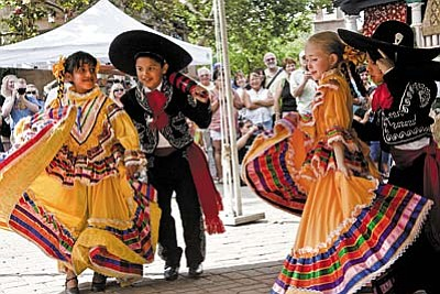 For pure exhilaration, gather for the colorful and exquisitely costumed dancers of all ages from Ballet Folkor y Cultura Mexicana. Pictured are up and coming dancers.