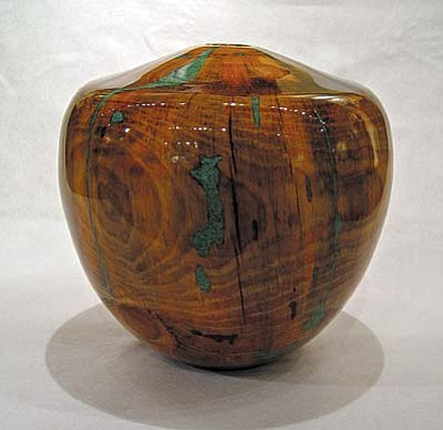 "By Robert Cherry, a hand-turned pine vessel measuring 14""h x 14""w x 14""d, is work by one of three artists attending Lanning Gallery's ""1st Friday"" reception on June 1."