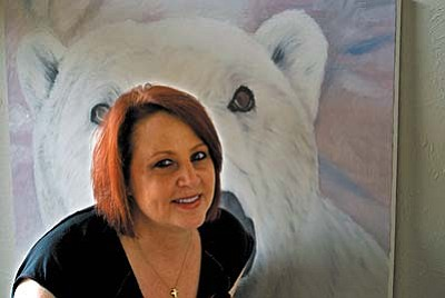 Cher Norville's paintings of wildlife were inspired by trips to Africa and Canada.