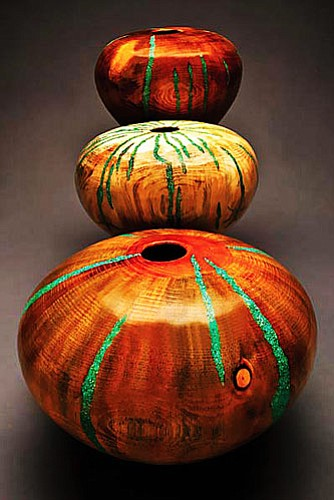 "Hand-turned Pine Vessels with Turquoise Inlay by Robert Cherry, ranging in sizes from 4"" to 20"" high, are part of ""Sculpted Nature: The Art of Hans Schiebold & Robert Cherry"" opening with a reception for both artists on 1st Friday at Sedona's Lanning Gallery."