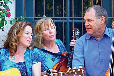 Red Rock Crossing Band is a versatile trio made up of Gary Tinstman on the stand-up bass, his wife Rochelle Tinstman on the mandolin and Terri Sue Rossi on rhythm guitar. Courtesy photo