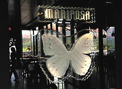A butterfly mirror reflects the red rocks back into the lounge at the Mariposa Latin Inspired Grill. (Photo by Vyto Starinskas)<br /><br /><!-- 1upcrlf2 --><br /><br /><!-- 1upcrlf2 --><br /><br /><!-- 1upcrlf2 --><br /><br /><!-- 1upcrlf2 --><br /><br /><!-- 1upcrlf2 -->