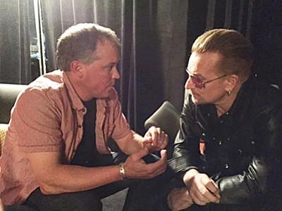 Bill Carter talks with musician Bono from U2.