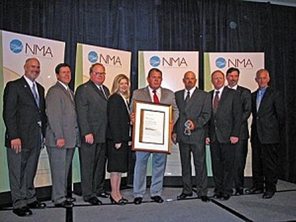 From left, Clarkdale Mayor Doug Von Gausig, Freeport-McMoRan Vice President of Human Resources Bill Rech, Freeport-McMoRan Americas President Red Conger, Freeport-McMoRan Environmental Manager of Remediation Projects Barbara Nielsen, Freeport-McMoRan Reclamation Services Superintendent of Operations Kevin Leonard, Freeport-McMoRan Reclamation Services Supervisor Brad White, Freeport-McMoRan Site Manager Duff Sorells, Freeport-McMoRan President and Chief Operating Officer Tim Snider, and Tuzigoot National Monument Chief Ranger Ed Cummins.