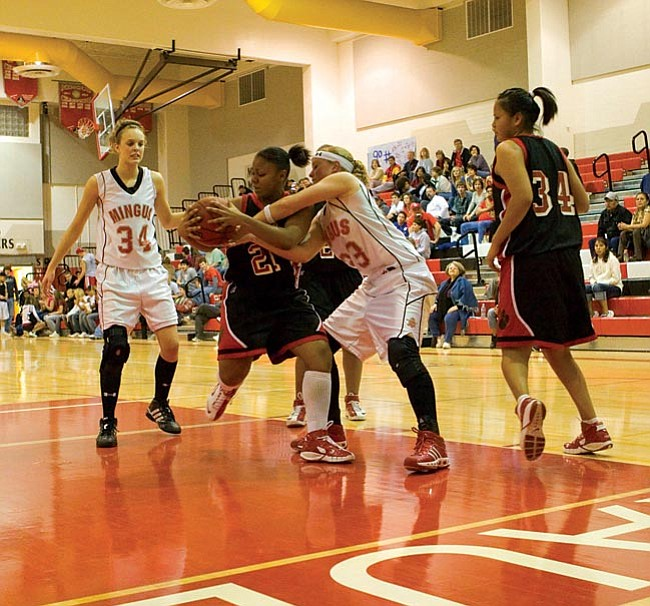 VVN/Shane DeLong Mingus' Tina Hagberg battles for the rebound with a Coconino player.