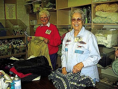 "Courtesy photo<br> Volunteers Barbara Wagner and Dorothy Cavanagh are happily at work in the Old Town Mission clothing room.  Dorothy received recognition for hitting a milestone 3000 hours of service at the recent OTM Winter Volunteer Appreciation Banquet. Nearly 85 of the 130+ annual volunteer core were in attendance to enjoy fun, food and festivities. Food was generously donated by Randall's Restaurant, Hacienda Restaurant, Food City and Verde Valley Medical Center. Live Music was performed by the group ""Work in Progress."""