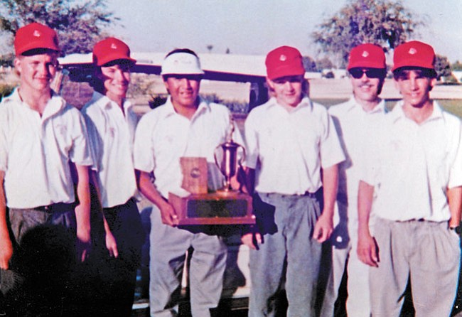 Courtesy Photo Marty James (holding trophy)  with the Mingus Union State Championship golf team.