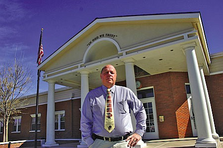 VVN/Philip Wright<br> Steve Anderson, director of American Heritage Academy, works in his office in the Cottonwood campus. Anderson started the charter school in 1995.