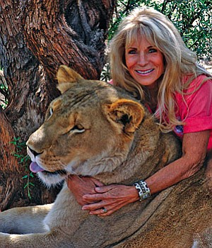 Prayeri Harrison, Founder & Co-Owner of Out of Africa Wildlife Park , Community Involvement