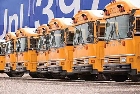 School buses may be sitting idle for summer vacation, but the fuel costs for running these yellow gas hogs has already affected the budgets of Verde Valley school districts for next school year. VVN/Shane DeLong