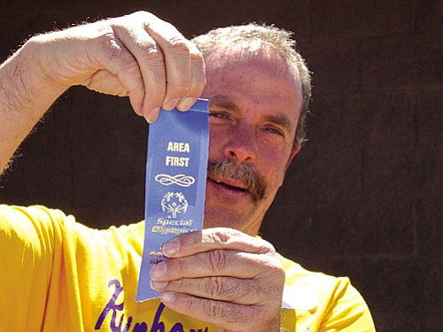 Jeff Pitts shows off his ribbon. He has been at Rainbow Acres since he was 18.