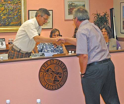 VVN/Philip Wright<br> Jerome Mayor Al Palmieri congratulated Gary McConnell, Jerome's new town manager, during Tuesday night's scheduled meeting. McConnell will begin his new position July 16.
