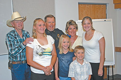 VVN/Philip Wright<br> Cottonwood's new police chief, Jody Fanning posed with his family after a special ceremony Tuesday afternoon. During the ceremony, Fanning and several officers were promoted and City Manager Doug Bartosh was officially retired from the department.