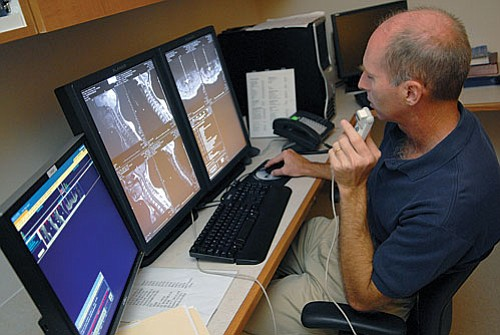 Radiologist Alan Wilson, M.D., dictates his findings in the new reading rooms of the Medical Imaging Department. The reading rooms now are located in a more private, quiet area of the department.