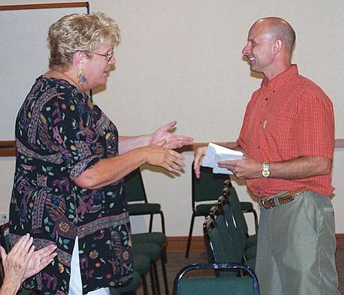 Susan Barrington, executive director, Sedona Community Foundation, receiving one of many grant checks presented to area nonprofits by Rob Arbogast, SCF advisory board member