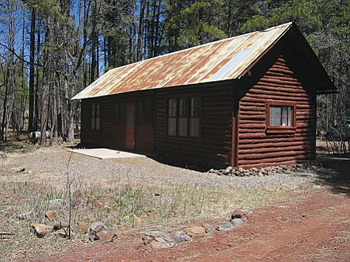 Photos courtesy USFS<br> The historic Apache Maid Cabin built in 1908 has been restored thanks to the efforts of Friends of the Forest volunteers and will be rented to the public beginning next spring. Two local ranchers, Charlie Babbitt and Biscuit Bill Dickison, originally built it as a line cabin.