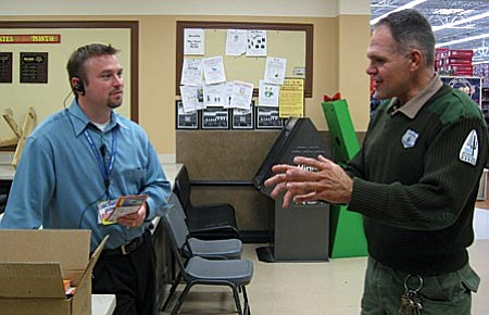 Wal-Mart Manager Roger Ferris diswcusses the Be a Roll Model program with Randy Victory, vice president of the Verde Valley Cyclists Coalition.