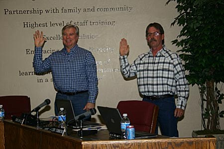 VVN/Philip Wright C-OC Board members Randall Garrison, left, and Eric Wyles were sworn in by Yavapai County School Superintendent Tim Carter Tuesday night. Both members were incumbents reelected during the November general election.