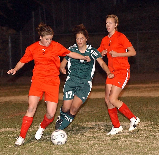 VVN/Wendy Phillippe Ali Adams and Jessie Zaske battle for the ball.