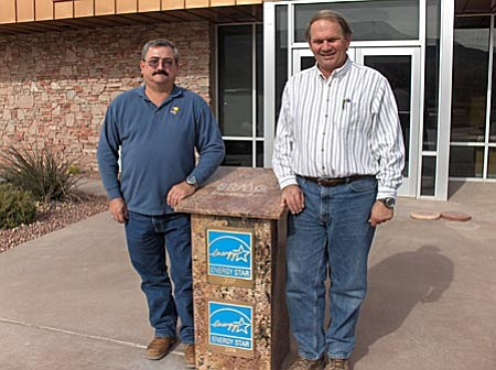 Lew Dodendorf, Energy Manager, and Gregg St. Clair, VP Cement Operations, pose in front of the Administration Building at the Salt River Materials Group Phoenix Cement plant in Clarkdale with the monument displaying the company's 2007 and 2008 ENERGY STAR™ plaques.