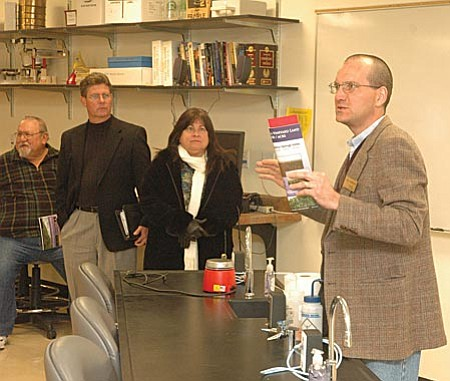 VVWC Gino Romero Yavapai College science professor Gino Romero, Ph.D., gave members of the Verde Valley Wine Consortium a tour of the college's science lab facilities on Wednesday, explaining how their current facilities could accommodate a future viticulture and enology lab.
