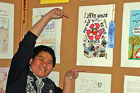 Big Park School student Gerard Regorgo celebrates his first place blue ribbon in the KSB Litter Prevention Poster competition.