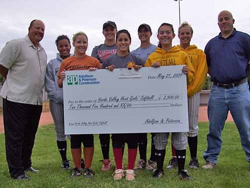 Courtesy Photo Adolfson & Peterson Construction Company donated $2,500 to the Verde Valley Heat softball team in the form of a big check.