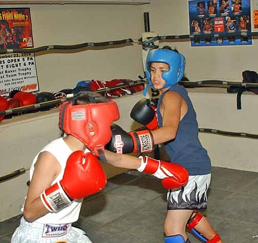 VVN/Wendy Phillippe Andres Ponce (blue) and Javier Mestas (red) work on their moves inside the ring.