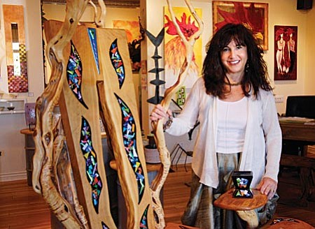 VVN/Jon Pelletier Donna Chesler stands inside the sculpture garden at her Gallery 527 located on Main Street in Jerome.