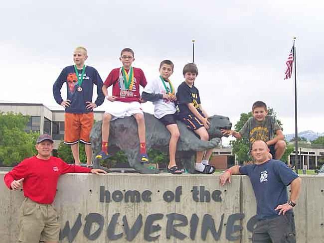 Courtesy Photo Kids placers Anthony Wokasch, Dalton Moran, Tristan Moran in front Utah State University entrance.