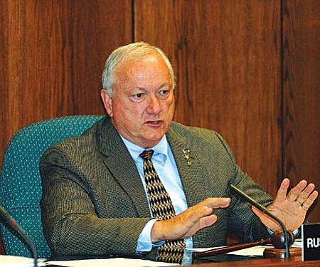 Capitol Media Services photo by Howard Fischer Sen. Russell Pearce, R-Mesa, votes Monday to send a measure to hike the state sales tax to voters but said he will help lead the charge to convince them to reject the measure. Pearce said only by killing the plan will lawmakers get the message to cut spending.