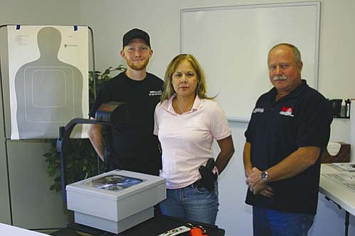 VVN/Philip Wright  Concealed Carry Weapons classes, as well as self-defense and home protection courses, will be taught at Arizona F.A.S.T. at 849 Cove Parkway in Cottonwood. Rick Weir, left, Chiquie Baker and John Baker will offer several courses on firearm handling, concealed carry and self-defense.