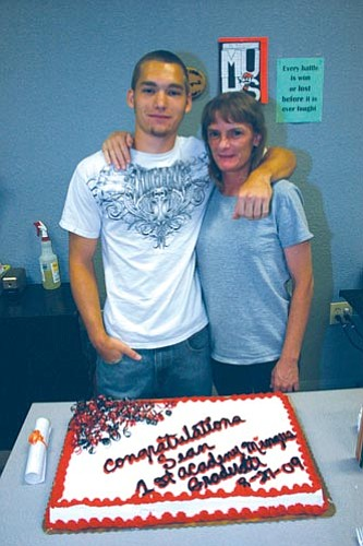 VVN/Philip Wright<br> Sean Rutledge (pictured with his mother Debbie) is the first graduate from The Academy at Mingus.