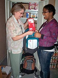 Courtesy photo<br> Merryl Dones, Beaver Creek School Title One Liaison, and Key Club Member Horizon Barnes prepare backpacks for the weekend&#160; student food distribution.
