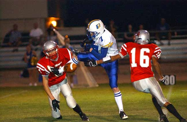 VVN/Wendy Phillippe The Mingus defense breaks up a Prescott pass play during the game Friday night.