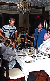 Alan McClean, Chef/Owner of Fork in the Road, receiving accolades from Tom and Pat O'Halleran (seated) and Dorothy O'Brien.