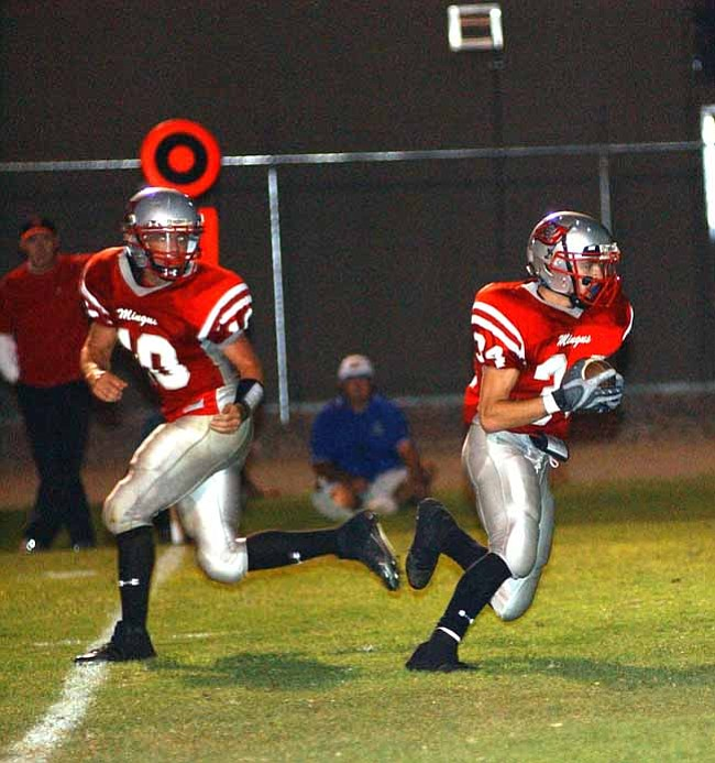 VVN/Wendy Phillippe Quarterback Nick Alred hands the ball off to Jesse Timm during the game against Prescott last week.
