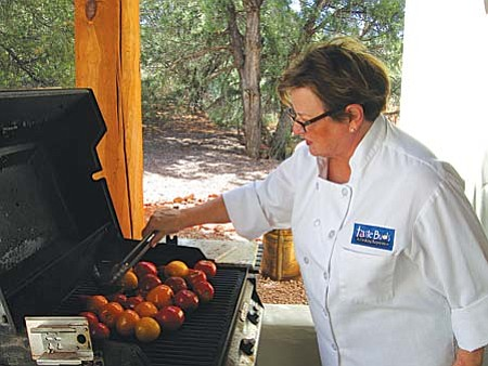 Karen Rambo turning roasted peppers and tomatoes