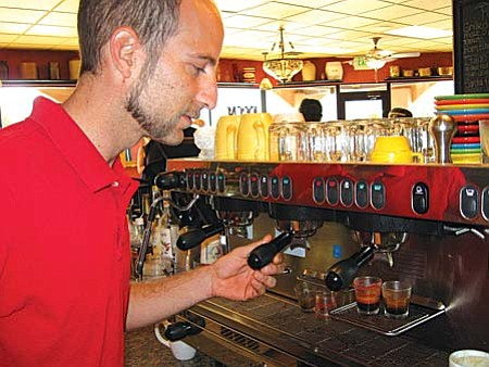 Barista Greg Suekoff preparing espresso